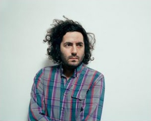 Daniel Bejar of Destroyer in plaid shirt