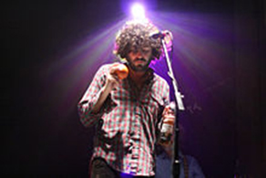 Daniel Bejar of Destroyer performing with beer and maraca