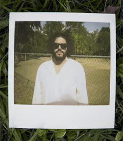 Daniel Bejar Destroyer wearing sunglasses and white shirt in polaroid picture