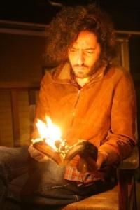 Daniel Bejar Destroyer reading a book on fire.