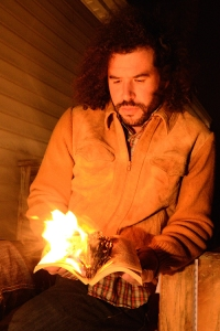 Daniel Bejar Destroyer reading a book on fire.